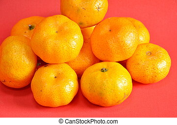 navel orange on red background