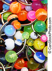 Navel Piercings - A giant pile of colorful belly rings.