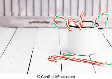 navidad, azucare caña, palos, en, estaño blanco, cup., luz, coloreado, photo., espacio, para, text.