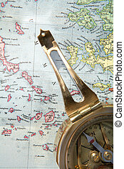 Navigation - A compass on a 1907 map of the Greek Aegean sea
