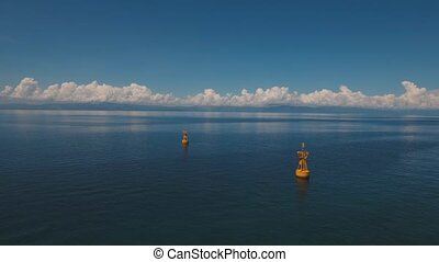 navigational buoy in the sea. - aerial footage orange...
