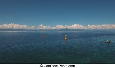 navigational buoy in the sea. - aerial footage orange...