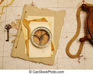 Navigational compass and papers on old map