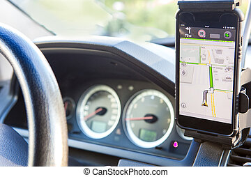 navigator on car dashboard - navigator on mobile phone on...