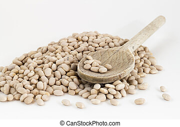 Navy beans in wooden spoon
