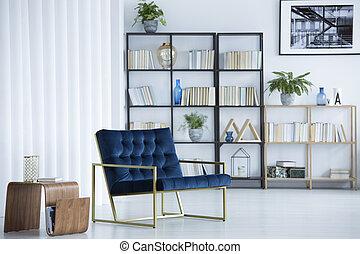Navy blue armchair in interior