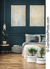 Navy blue bedroom with art - Potted plants in yarn baskets ...