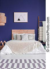 Navy blue cozy bedroom interior