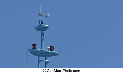 Navy Devices on Ship Mast - Navigation gear on the top of a...