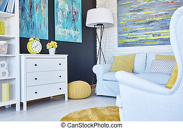 Navy room with yellow pouf