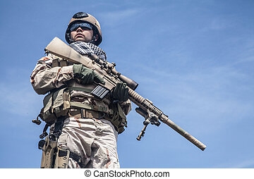 Navy SEAL in action - Member of Navy SEAL Team with weapons...