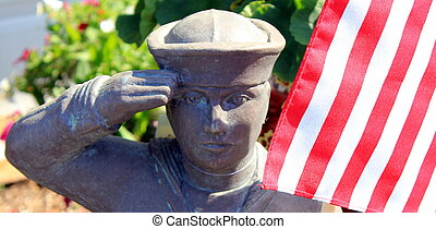 Navy statue saluting the flag - Statue of navy man saluting...