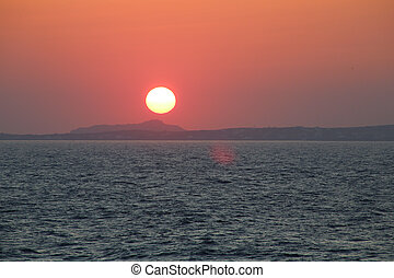 Naxos - Sunset at the Portara Gate of the Apollo Temple in...