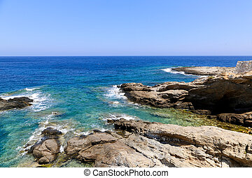 Naxos - The blue see and rocks of Apollonas in Naxos
