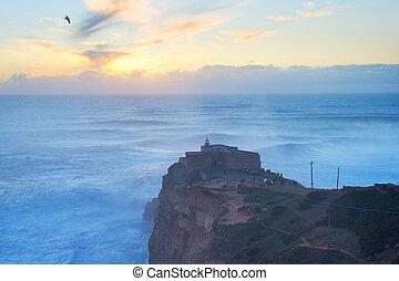 Nazare lighthouse sunset ocean Portugal