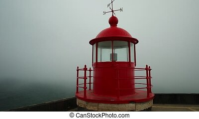Nazare red Lighthouse - Round view of red lighthouse or...