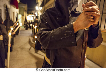 Nazareno with his clothes full of candle wax, Holy week, Spain