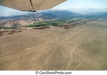 Nazca or Nasca mysterious lines and geoglyphs aerial view, landmark in Peru