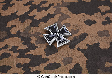 nazi german award Iron Cross on SS camouflage uniform