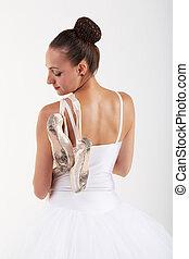 ne young woman ballerina ballet dancer dancing with tutu