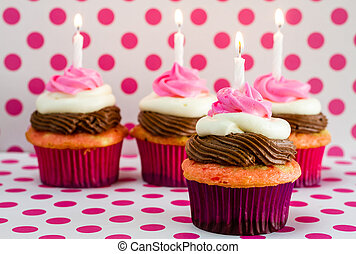 Neapolitan Cupcakes - Line of 4 neapolitan frosted cupcakes...