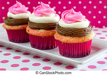 Neapolitan Cupcakes - Line up of 3 neapolitan frosted...