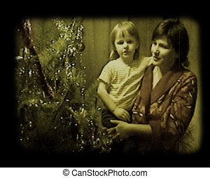 mother and her little daughter near the christmas tree stylized at old movie