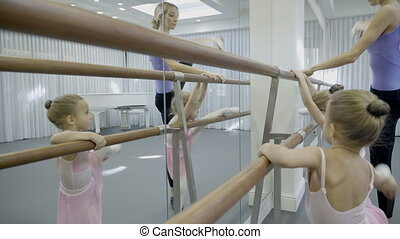 Near wooden ballet machine, learn teacher and young...