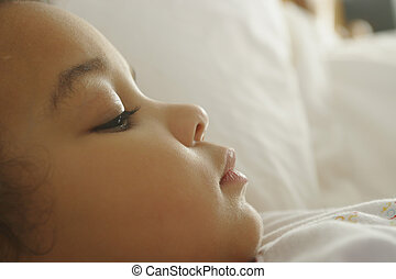 Nearly Asleep - A young mixed race girl on the verge of...