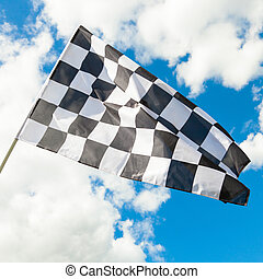Neat checkered flag waving in the wind - clouds on...