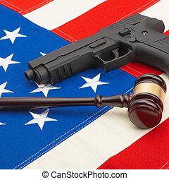 Neat judge gavel and gun over USA flag - studio shoot