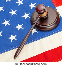 Neat judge gavel and soundboard over US flag