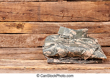 Neatly folded military camoflage uniform. Soldier clothes on...