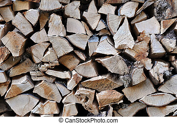 Neatly stacked firewood for winter