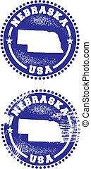 A couple of distressed stamps featuring a unique Nebraska state design.