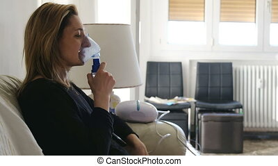 nebulizer aerosol woman inhaler machine medicine at home .