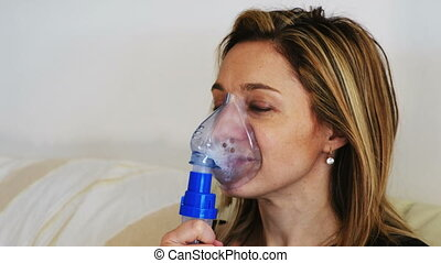 nebulizer aerosol woman portrait holding inhaler machine .