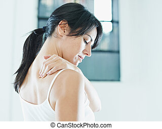 nechache - woman massaging neck. Side view, copy space