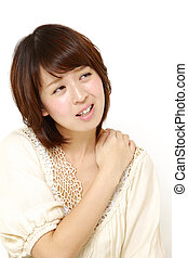 neck ache - studio shot of young Japanese woman on white...
