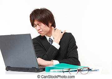 neck ache - studio shot of young Japanese businessman on...