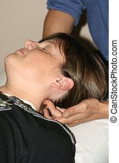 neck adjustment - Woman having chiropractic adjustment