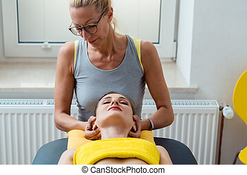 Neck and head massage in the physical therapy