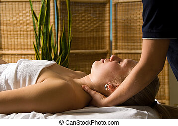 Neck massage - woman in a day spa getting a neck massage