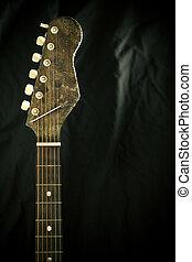 Neck of a guitar - A bright guitar neck on a black...