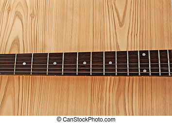 Neck of guitar - Brown wooden neck of a guitar over a lite ...