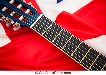 Neck of the guitar on the background of the flag of Britain