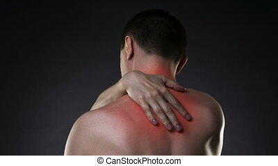 Neck pain, man with backache on black background with red...