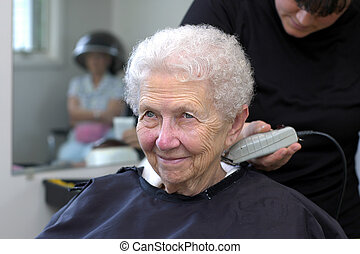Neck Shave - Senior woman getting her styled hair shaved at