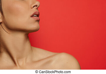 neck, shoulder, and lips of young woman