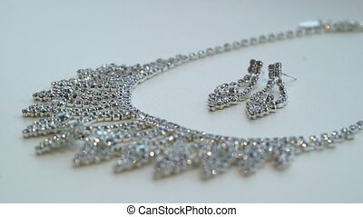Necklace and earrings on white background